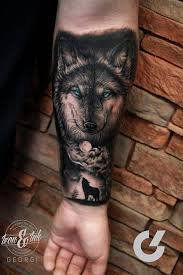 Forearm Wolf - black and grey style wolf on the left inner forearm