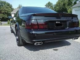 blacked out cadillac seville on blacked images tractor service