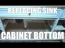 sink kitchen cabinet base repair replacing a sink base cabinet bottom floor after water leak