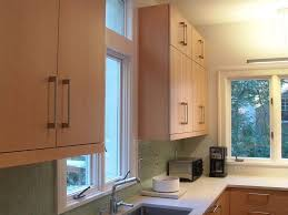 ivory light wood tone cabinets stainless steel undermount sink