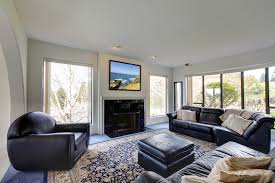 living room with tv over fireplace interior design