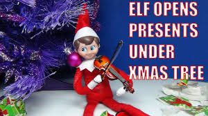 elf on the shelf opened the presents under christmas tree plays