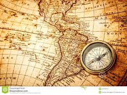 Ancient World Map by Vintage Compass Lies On An Ancient World Map Stock Photo Image