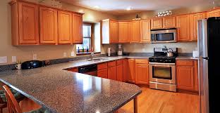 Updating Oak Kitchen Cabinets Red Quartz Countertops Updating Oak Kitchen Cabinets Oak Kitchen