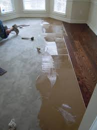 Laminate Floor Adhesive A Home Remodel Series Part 4 How To Install Wood Flooring A