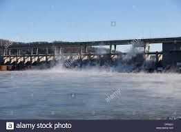steam rises from the spillways of the chickamauga dam on a very
