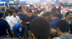 black friday fights in walmart pepper spray and black friday sales madness as grandfather body