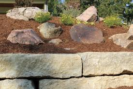 custom boulder wall with belgard patio breck outdoor services