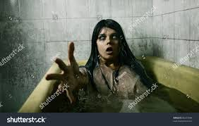 scary bath stretching her hand stock photo 85315546