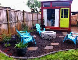 different take on backyard shed by firepit cabin screen
