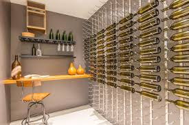 modern wine cellar with built in bookshelf u0026 carpet in los altos