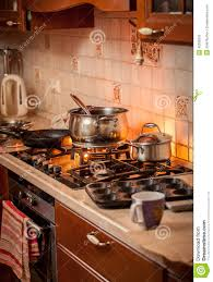 pan boiling on burning gas stove on country style kitchen stock