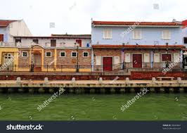 dutch colonial architectural building along riverfront stock photo