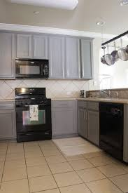 kitchens with white cabinets and black appliances small kitchen designed with black appliances and white cabinets