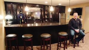 some women hesitate to hire or talk about hiring a housekeeper tim rosene owner of studs to rugs sits at the bar of a fargo