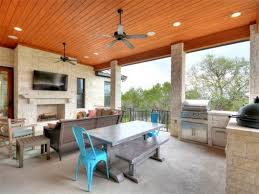 contemporary porch with outdoor kitchen u0026 outdoor fireplace in