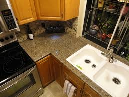 Kitchen Sink Area Finished With Lazy Granite Tiles And Bullnose - Kitchen sink area