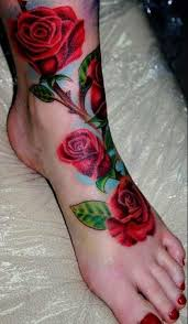 beautiful red rose tattoos on left foot