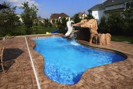 exterior swimming pool with water fall and white curved water