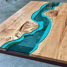 wood tables and wall embedded with glass rivers and lakes by