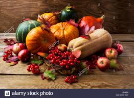 fall concept with pumpkins apples and berries thanksgiving stock