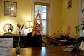 Desk Yoga Poses Five Yoga Poses You Can Do At Your Desk Sarasota Magazine