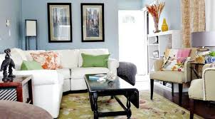 small living room with pastel blue wall colors and white sectional