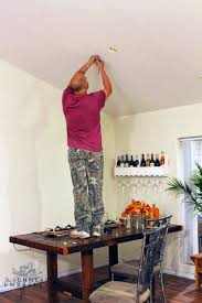 how far above a table should the bottom of a chandelier hang how
