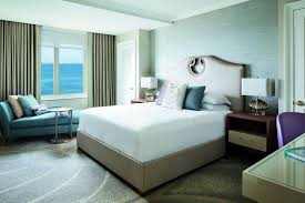 the bay view suite in florida the ritz carlton sarasota bedroom with a chaise in front of an ocean view window