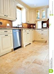 Kitchen Tiles Floor by Kitchen Floor Tile Designs With Cream Colors And White Cabinet