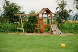 backyard play area with grass and wood chips amys office