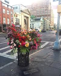 floral designer lewis miller turns nyc trash cans into bountiful