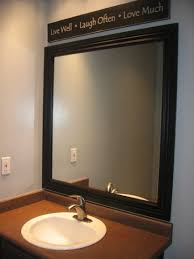 gray wall paint mirror without frame black backsplash tile white