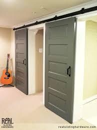 sliding doors on rails sliding barn doors laundry room white