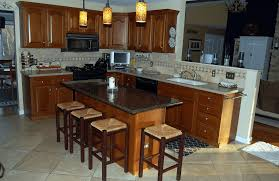 kitchen island with breakfast bar and fabulous granite top kitchen