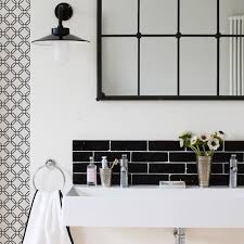 bathroom black and white white tube stool white cabinet with metal handles light grey sofa