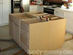 your own kitchen island diy kitchen island from stock cabinets diy home