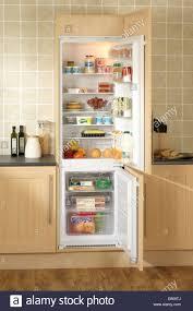 chilled food in a built in fridge freezer in oak kitchen units