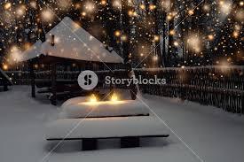 christmas lights on winter night background snowy winter