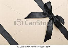 black satin ribbon black satin ribbon and bow on cardboard background stock image