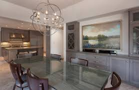 decor transitional dining room using globe chandelier and elegant