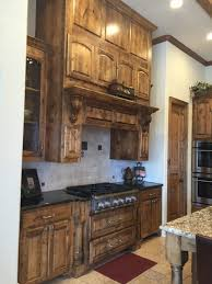 White Knotty Alder Cabinets Went From Brown Knotty Alder Kitchen Cabinets To White