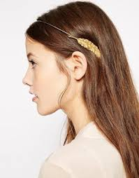 how to wear hair behind the ears how to wear holiday hair accessories without looking like a giant