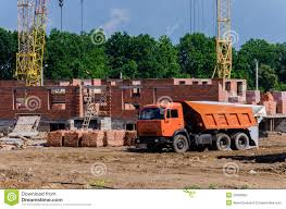 construction of a small suburban brick house construction machi