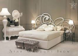 i would love this wrought iron headboard in an antique gold white