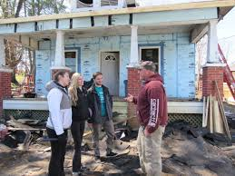 habitat for humanity volunteers begin renovating old houses for