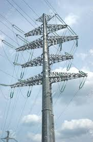 imagenes de bottom up high voltage power line grey metal prop with many wires over cloudy