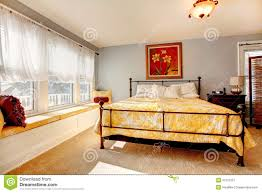 gentle cozy bedroom with rustic iron frame bed royalty free stock