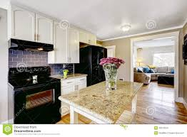 kitchen island with granite top and flowers stock photo image