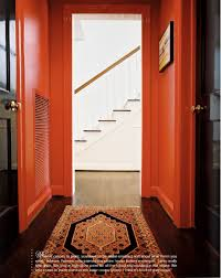 this warm red hallway feels glamorous and adds excitement to the
